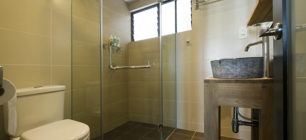 Second bathroom with granite basin, heated shower, twin-flush toilet