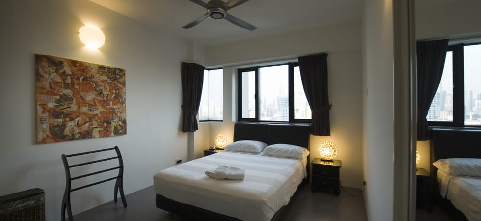 Master bedroom with queen size bed and city view