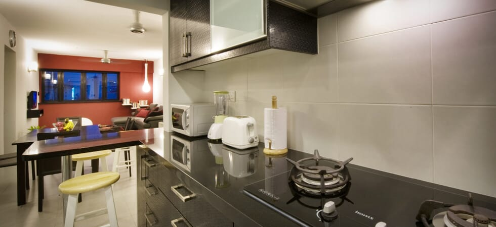 Fully-equipped kitchen with black granite counter top