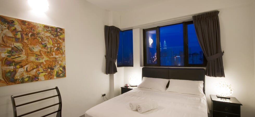 Master bed with view of twin towers