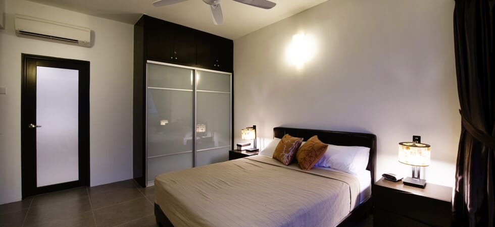 Master bedroom with queen size double bed and sliding wardrobe