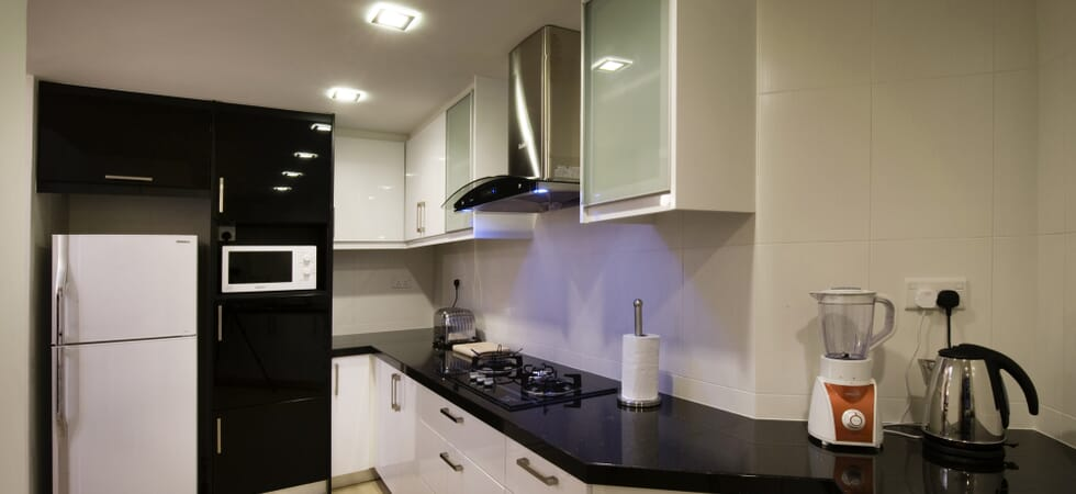 Fully equipped kitchen with blender, kettle, toaster, microwave, fridge freezer, oven and gas stove