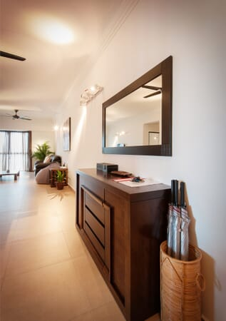 Entry with console table, mirror and umbrellas
