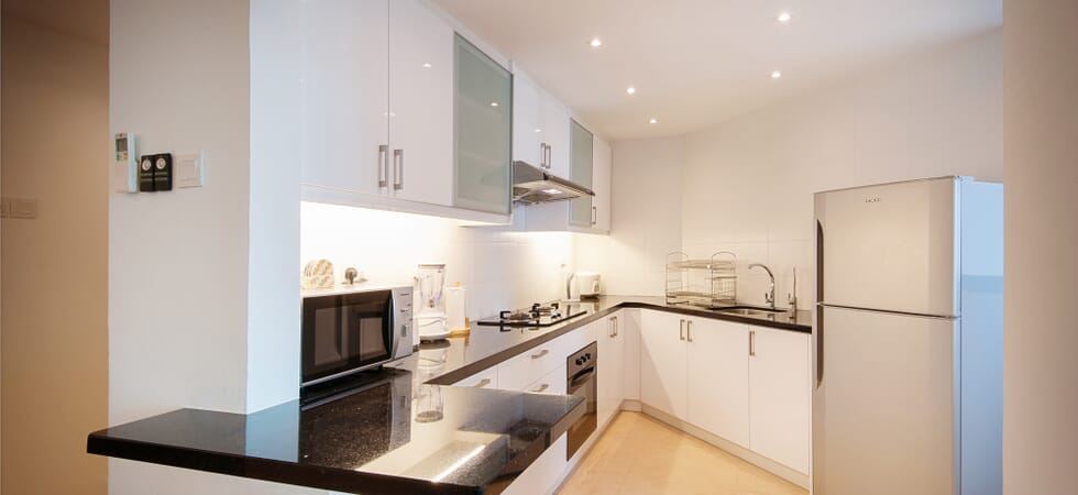 Beautifully finished granite worktop kitchen with high gloss cabinets